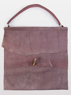 Suede Native Bags with a faux lion's tooth marble clasp